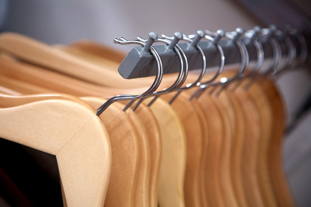 empty hangers in a row at a retail store.jpeg