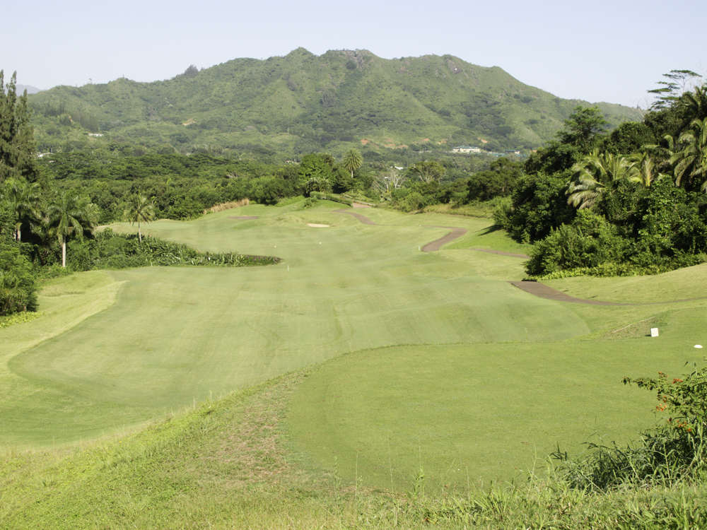View of rolling fairway from teeing grounds on golf course in Hawaii
